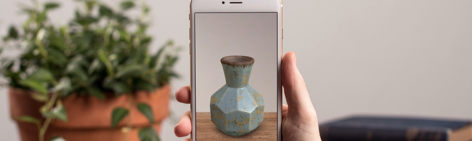 Viewing an AR vase on a shelf